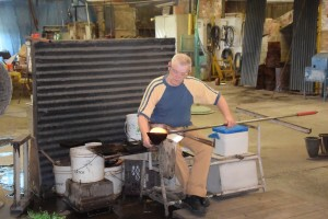 A glassblower works at Blenko Glass